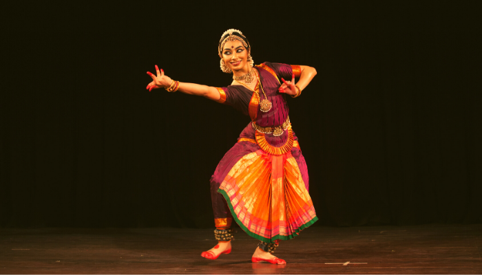 Young Bharatnatyam female artist points at the handsome lord during 'Manamohana event' by Chithkala school of dance on December 6,2018 at Sevasadan hall in Bengaluru,India