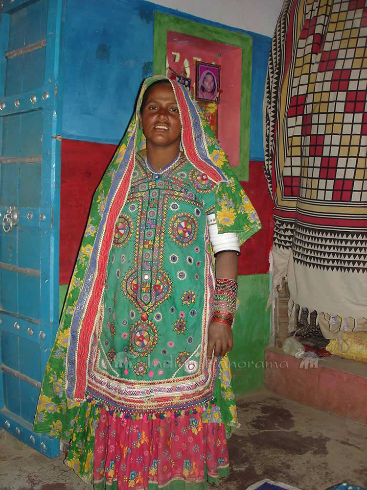 Colourfully dressed local village woman