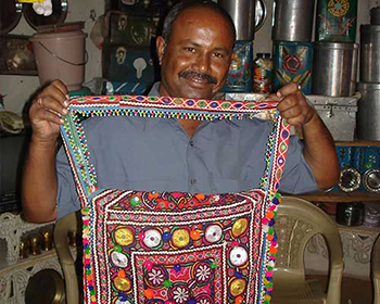 Villager showing some local crafts