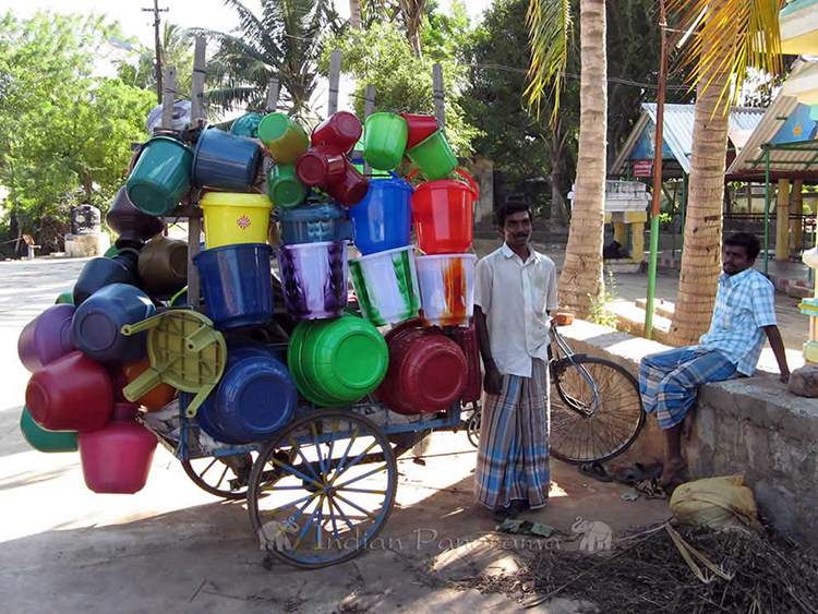 Bucket vendor on a bike - near Cardamom House, Dindigul
