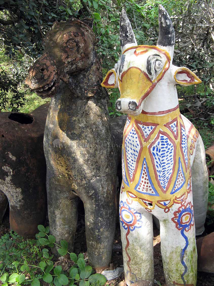 Ancient pottery animals line Ayyanar Temple