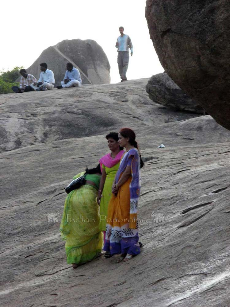Tourist at Krishna's Butterball Rock, Mahabalipuram