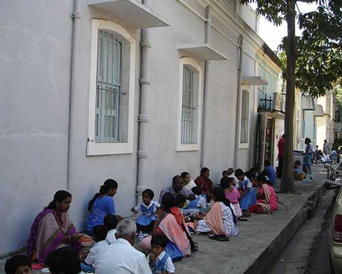 School Lunchtime On A Pondicherry Footpath