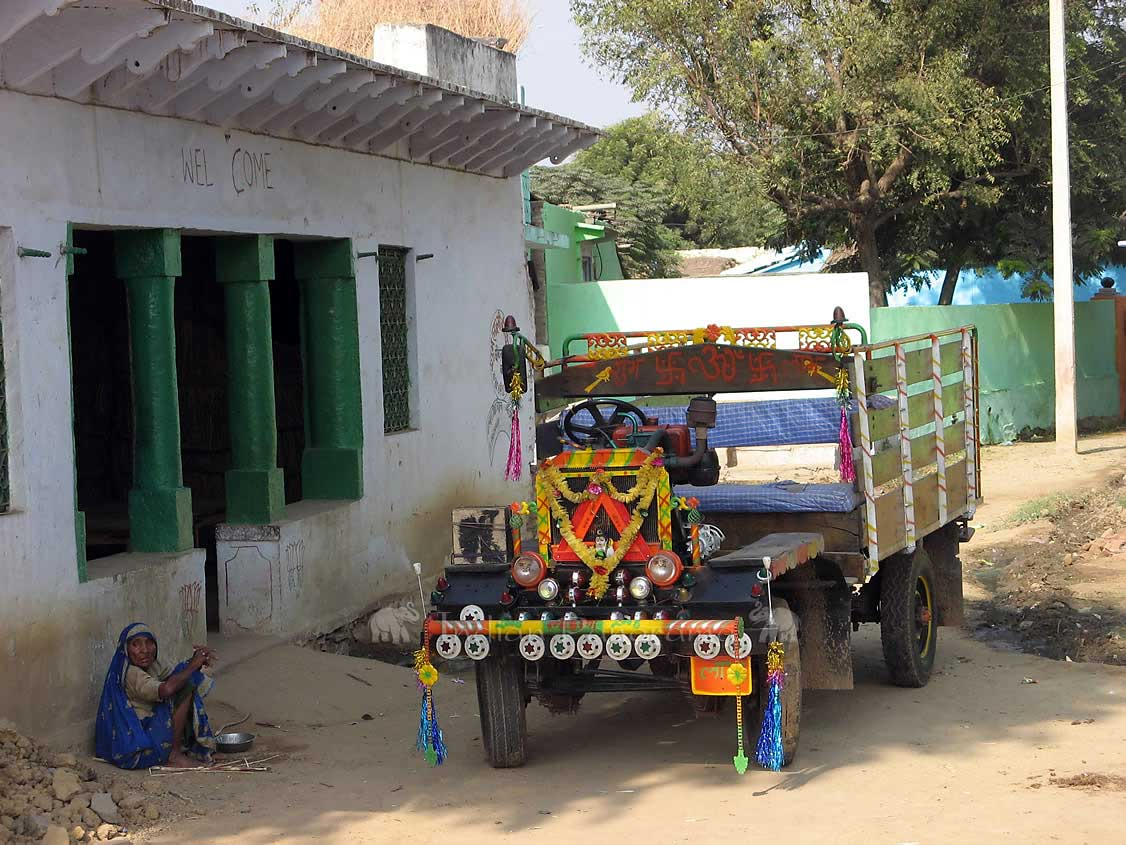 Village House And Ornated Truck