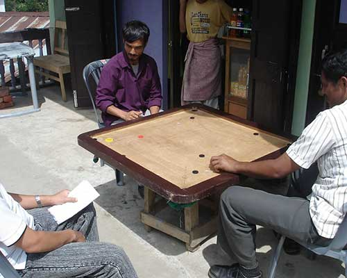 Playing Carrom on the streets outside Gompa