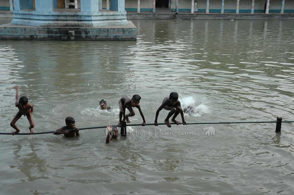 Boys Enjoying A Swim In Temple Tank