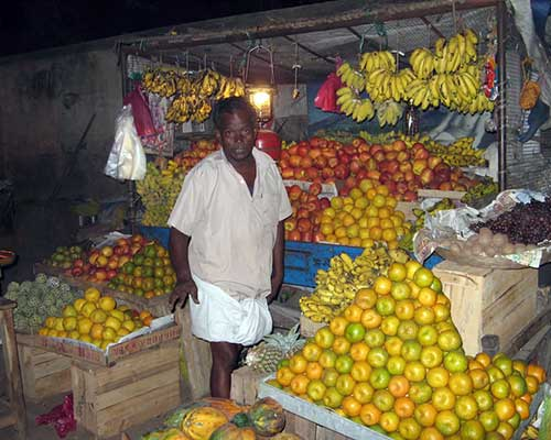 Fruit Seller At A Local Market