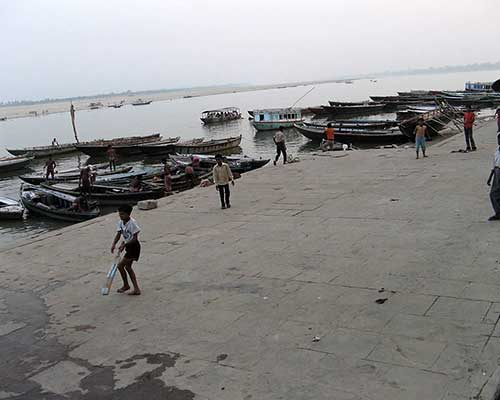 Varanasi Children Playing Cricket On The Banks Of River Ganges