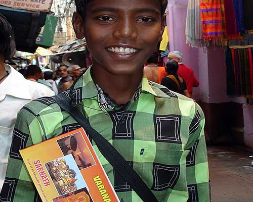 Our friend Rahul selling postcards in Varanasi
