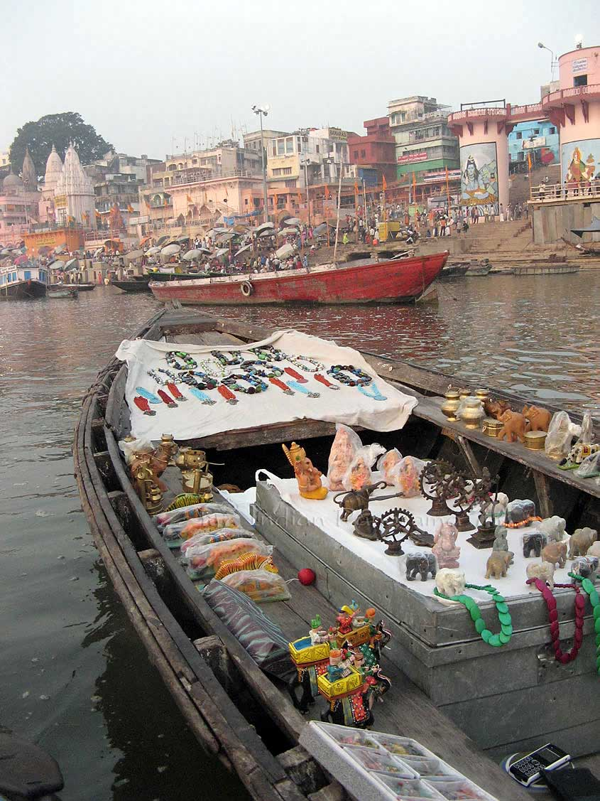 Boat vendor with view back to the Ganges Ghats