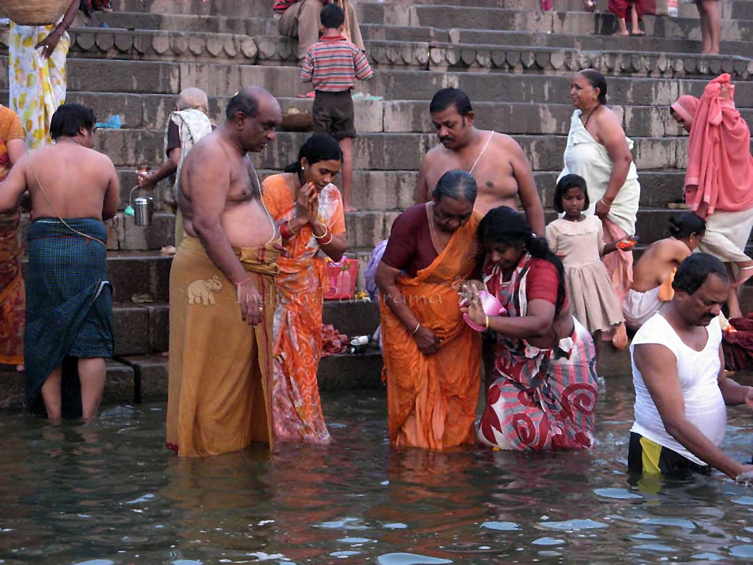 Prayers to the rising sun in the Ganges Ghats