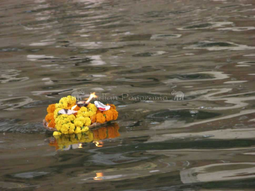The flower and candle offering for puja